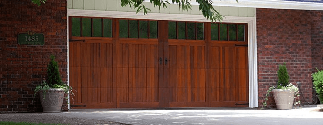 Carriage house garage doors midwest garage doors blog for Best wood for garage doors
