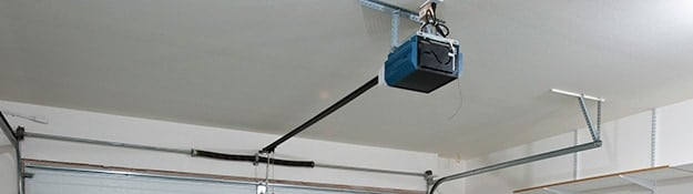 Garage door opener on the ceiling of a garage